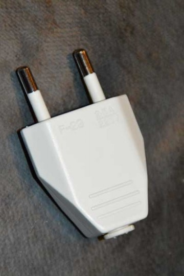 White or black electrical outlet.